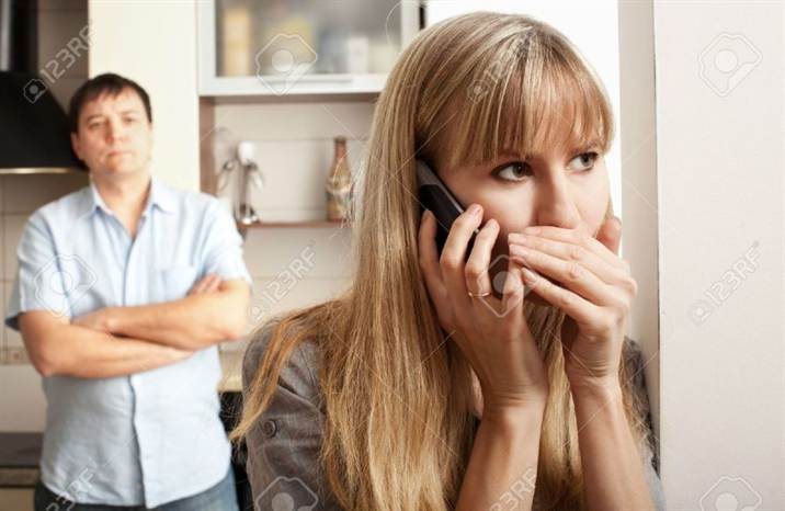 4_11954851-wife-confer-privately-on-the-phone-stock-photo